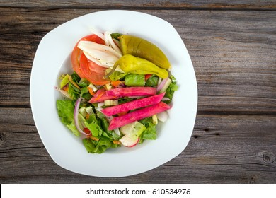vegetable salad with pickled turnip and pepperoncini