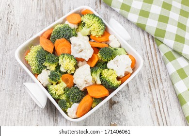 Vegetable Salad. Raw vegetable salad greens made from broccoli, cauliflower and carrots. Raw food. diet. Vegetarian. Macrobiotic. Copy space composition