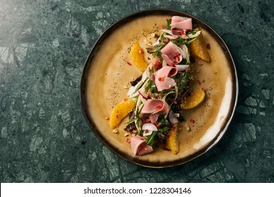 Vegetable salad with Smoked duck breast, close-up.  Healthy fresh vegetable salad with smoked chiken meat, Candied Walnuts, Spring Greens, Orange and Herbs