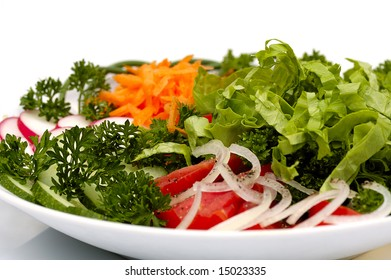 vegetable salad with tomatoes, cucumbers, lettuce, drill, parsley