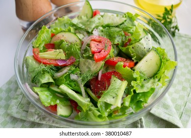 Vegetable salad of tomatoes, cucumbers and lettuce