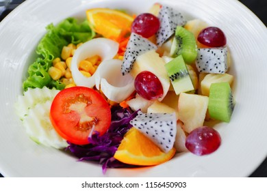 Vegetable salad with Tropical fruit on White plate, Healthy Diet for Weight Loss.