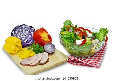 Vegetable salad with white cheese and ham with ingredients on chopping board, isolated on white.