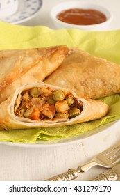 Vegetable Samosas a spicy blend of vegetables wrapped in a deep fried triangular pastry parcel