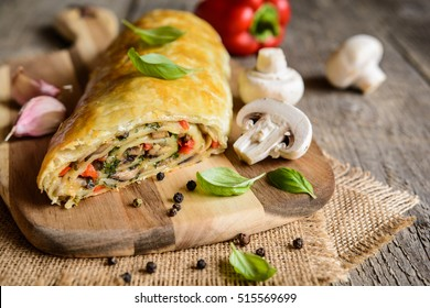 Vegetable savory strudel stuffed with mushrooms, red pepper, onion, garlic and parsley