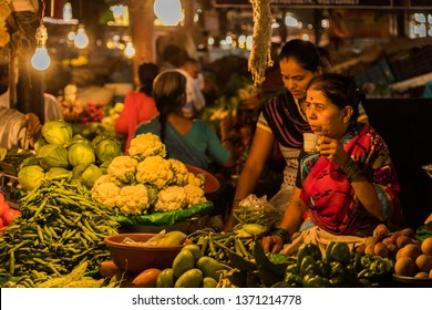 Vegetable seller in Pune market Mandai - 2016 in beautiful tungsten light   Mandai is famous market in center of Pune city which is historic & old.