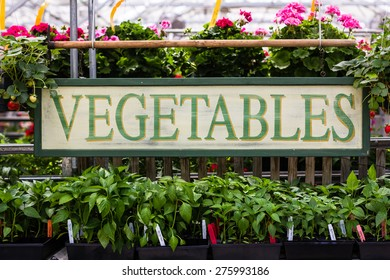 Vegetable sign at a market.