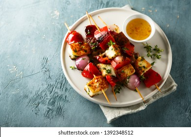 Vegetable skewers with halloumi cheese
