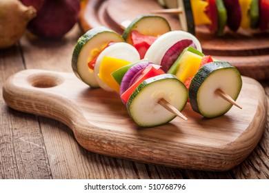 Vegetable skewers prepared for baking. Selective focus.