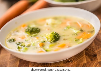 Vegetable soup from broccoli carrot onion and other ingredients. Healthy vegetarian food and meals.
