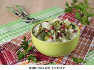 Vegetable soup made from cabbage, broccoli, cauliflower, beans and cream in a bowl