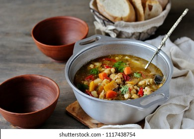 vegetable soup minestrone in a cast-iron pan. country style.