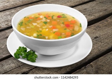 Vegetable soup on woden table
