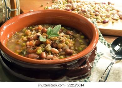 Vegetable soup served inside a earthenware bowl