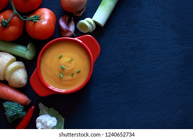 Vegetable Soup surrounded by assortment of Veg