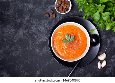 vegetable soup in a white bowl on a black background. view from above