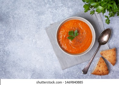 vegetable soup in a white bowl on a gray background. view from above