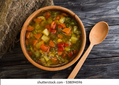 Vegetable soup in a wooden plate. Useful and tasty food.