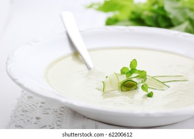 Vegetable soup with zucchini in a white plate