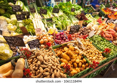 Vegetable stall on the produce market in Vienna, Austria. Fresh potatoes, salad, greens
