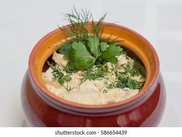 Vegetable stew cooked in a pot with fresh herbs