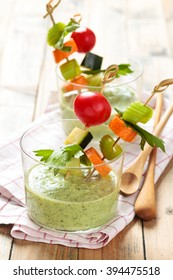 Vegetable sticks and green cold soup (gazpacho) .