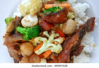 Vegetable stir fried in oyster sauce on steamed rice