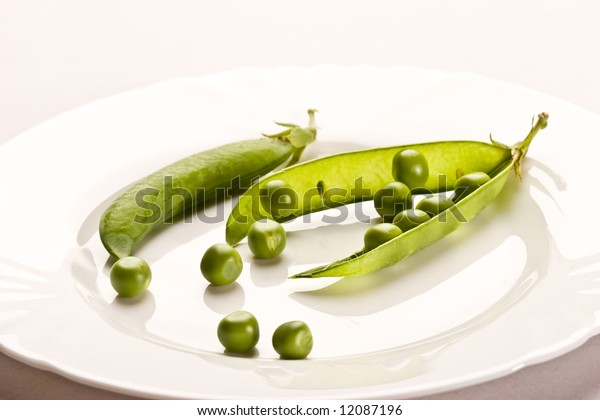 Vegetable theme: pea pod on the white plate