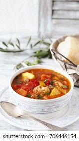 vegetable thick soup minestrone without pasta. minestrone with tomatoes, yellow zucchini, eggplant, red pepper, carrots, cauliflower.