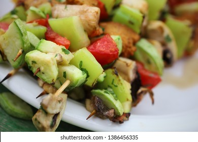 Vegetable vegan skewers with seitan, mushrooms, zucchini, tomato and bell peppers