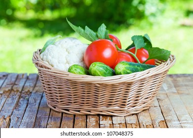 vegetables in basket on a old wood table