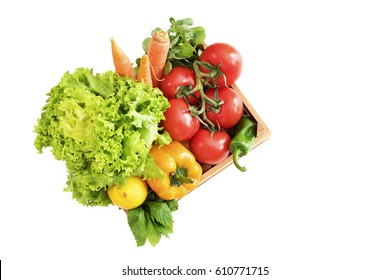 Vegetables in basket on white background