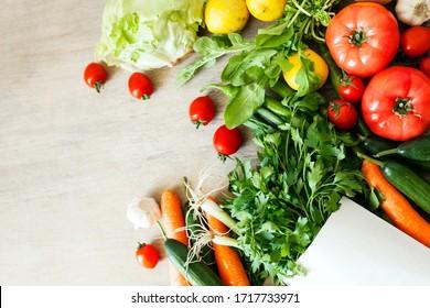 Vegetables in the basket organic vegetables on wooden background