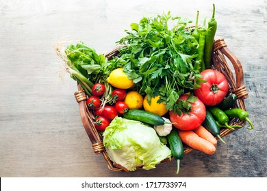 Vegetables in the basket organic vegetables on wooden background