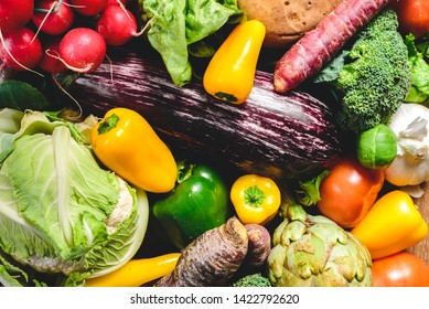 Vegetables, best health foods, radishes, onions, garlic, peppers, cabbage, broccoli.