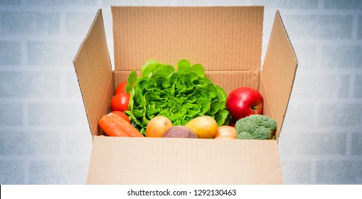 Vegetables in box, delivery box. Fresh fruits vegetables.