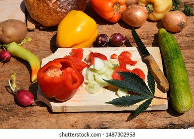 Vegetables with cannabis on wooden table.