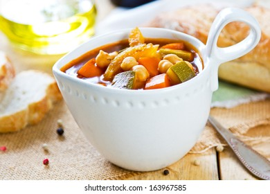 Vegetables with Chickpea soup by loaf of bread