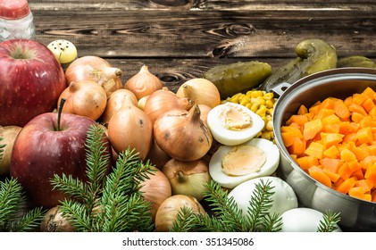 Vegetables for christmas salad on wooden table.