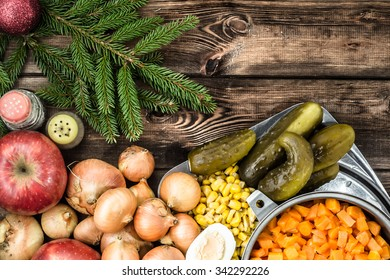 Vegetables and christmas tree on wooden table.