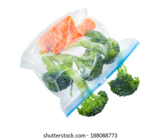 Vegetables in clear plastic bag isolated on white background .