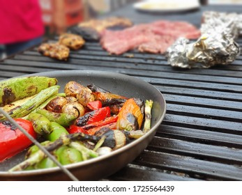 Vegetables in close up and steak on background