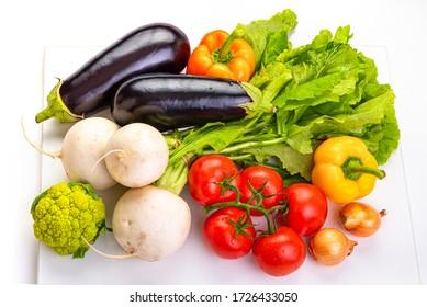 Vegetables for cooking. Eggplant, tomatoes, onions, paprika, cauliflower, white radish.