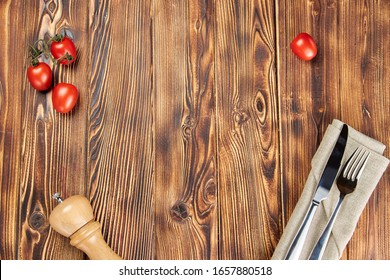 vegetables and Cutlery on a wooden table