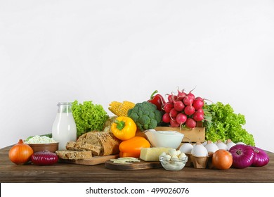 Vegetables and dairy products on wooden table