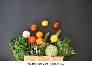 Vegetables dark background with copy space. Grocery basket, package with vegetables. Healthy diet. Vegetables on black background for advertising - Shutterstock ID 1810559569