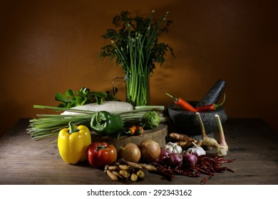 Vegetables and equipment for food on wooden table, still life style