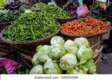 Vegetables at a ethnic street market; Salad, Green Beans, Tomatos