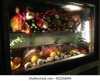 Vegetables and fish displayed in a restaurant window