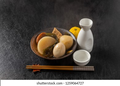 vegetables, fish dumplings and various other articles of food stewed in a thin soy soup, and served hot.japanese foods(oden)